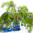 Photo: Christmas decoration on fir-tree branches with toys and soap bubbles