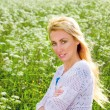 Female portrait against a meadow with white colors — Стоковая фотография
