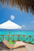 Parasol and chaise lounge on a terrace of water villa, Maldives — Stock Photo