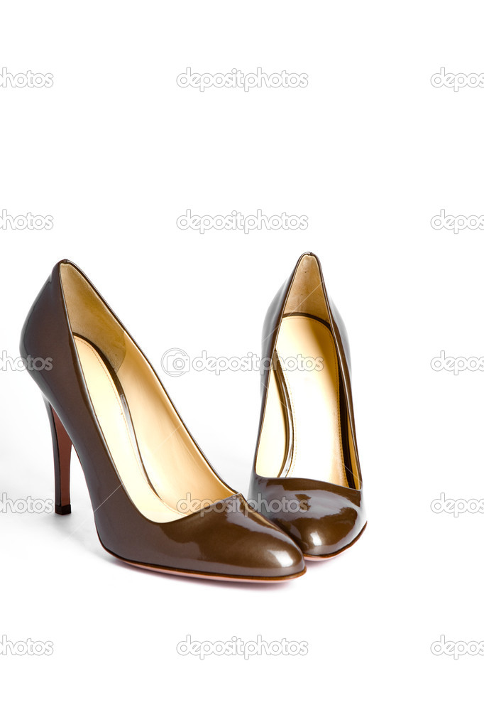 Beige-golden female new varnished shoes on high heel-stiletto — Stock Photo #3762460