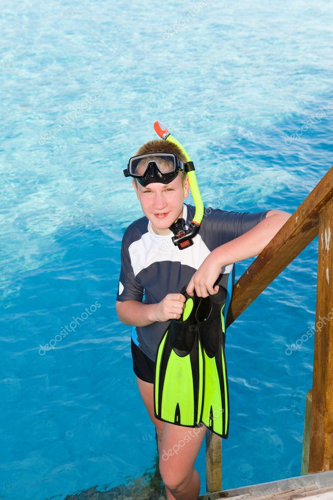 The boy with flippers mask and tube for scuba diving for Dive tube
