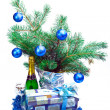 Of a branch with balls, a gift box, sparkling wine — Stock Photo #3912025