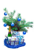 Of a branch with balls, a gift box, sparkling wine — Stock Photo