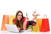 Beautiful young woman shopping over internet — Stock Photo