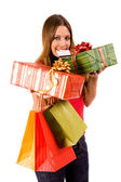Beautiful shopping girl with colorful bags and package — ストック写真