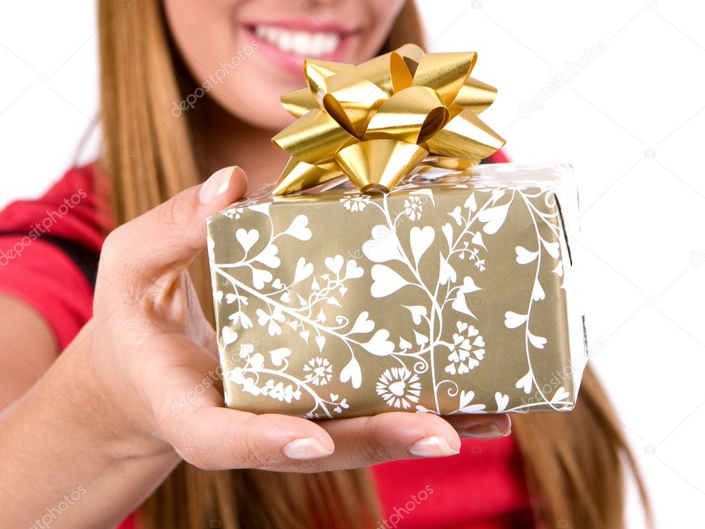 Woman giving gift box with bow.  Stock Photo #3324058
