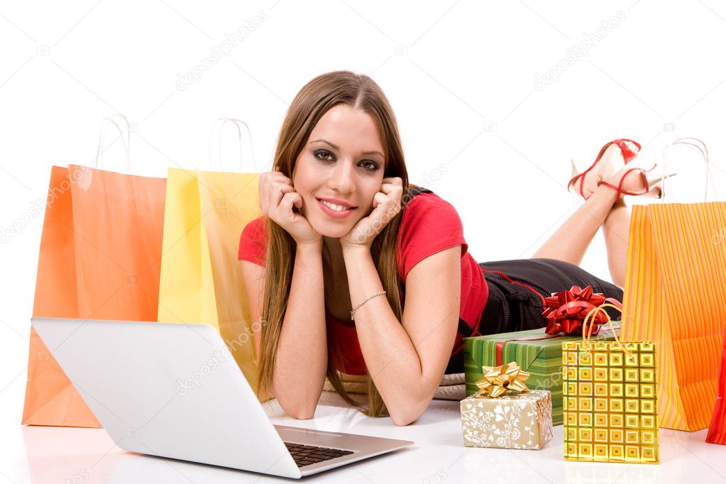 Beautiful young woman shopping over internet. — Stock Photo #3324496