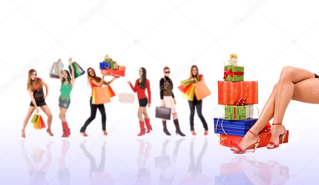 Shopping woman with bag and gift boxes and blurred girl in background.  Stock Photo #3404519