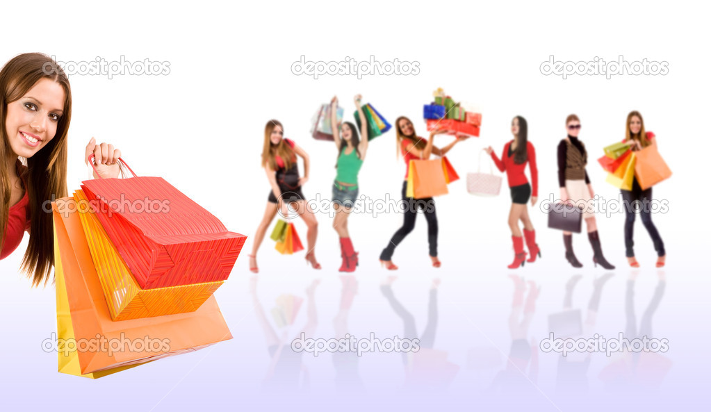 Shopping woman with bag and gift boxes and blurred girl in background. — Stock Photo #3404537