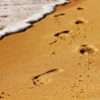 Footsteps on the beach. — Stock Photo