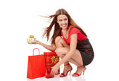 Beautiful shopping girl with colorful bags — Stock Photo