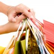 Stock Photo: Female hands hold colorful shopping bag
