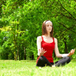 Yoga pose outdoors — Stock Photo