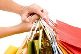 Female hands hold colorful shopping bag — Stock Photo