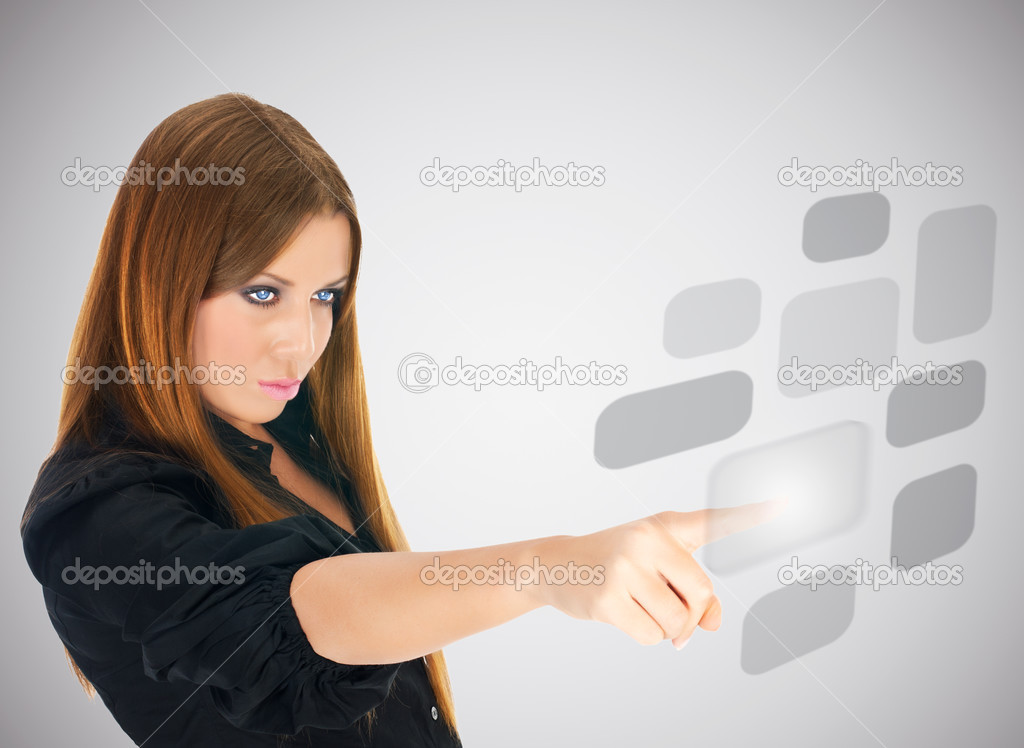 Businesswoman pushing button on screen interface.  Stock Photo #3828127