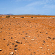 Red rocky desert in Fuerteventura - Stock Photo