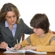 Mother helping her child with homework — Stock Photo