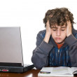 Teenager tired studying for examination — Stock Photo #3063514