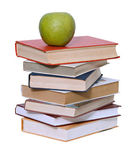 Green apple on pile of books on white background — Stock Photo