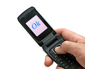 """Mobile phone with """"Ok"""" shown on its screen — Stock Photo"""