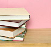 Pile of colorful books isolated on pink backgrou — Stock Photo