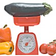 Stock Photo: Kitchen scale weighting eggplant