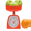 Stock Photo: Kitchen scale weighting apples