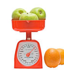 Kitchen scale weighting apples — Stock Photo