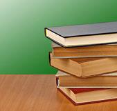 Books on desk — Stock Photo