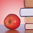 Royalty-Free Stock Photo: Red apple and books