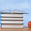 Stock Photo: Red apple and books