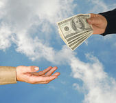 Transfer of money between man and woman — Stock Photo