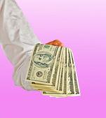 Hand with dollar bills — Stock Photo