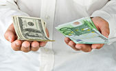 Man with euro and dollars — Stock Photo