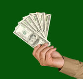 Hand with dollars — Stock Photo