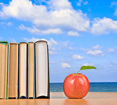 Apple and books — Stock Photo