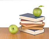 Apple on book on white background — Stok fotoğraf