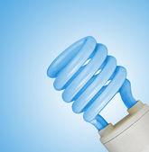 Lamp on blue background — Stock Photo