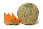 Melon and three segments isolated on white background — Stock Photo