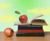 Red apples and open book — Stock Photo