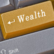 Keyboard with key for  wealth - Stock Photo