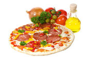Pizza with salami and vegetables — Stock Photo