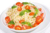 Pasta with tomato and basil — Stock fotografie