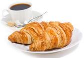 Croissant en koffie — Stockfoto