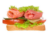 Sandwich with smoked salmon and vegetables — Stock Photo