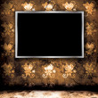 Photo frame on grunge wall — Stock Photo