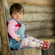 Girl on the wooden chair — Stock Photo