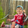 Beautiful girl on the swings — Stock Photo