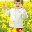 Beautiful girl in canola field — Stock Photo