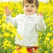 Beautiful girl in canola field — Stock Photo #2762250